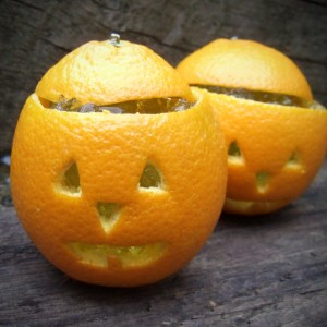 Jack O' lanterns made from orange and filled with jelly