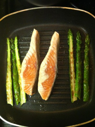 Grill the salmon in the centre and continue to cook the asparagus