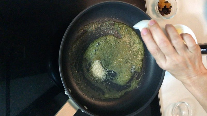 Add some sugar in a pan with melted butter
