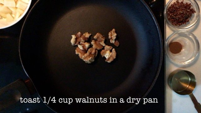 toasting some walnuts on a dry pan