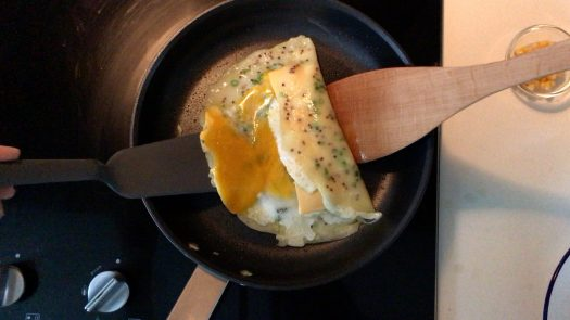 Folding up the pancake with two spatulas