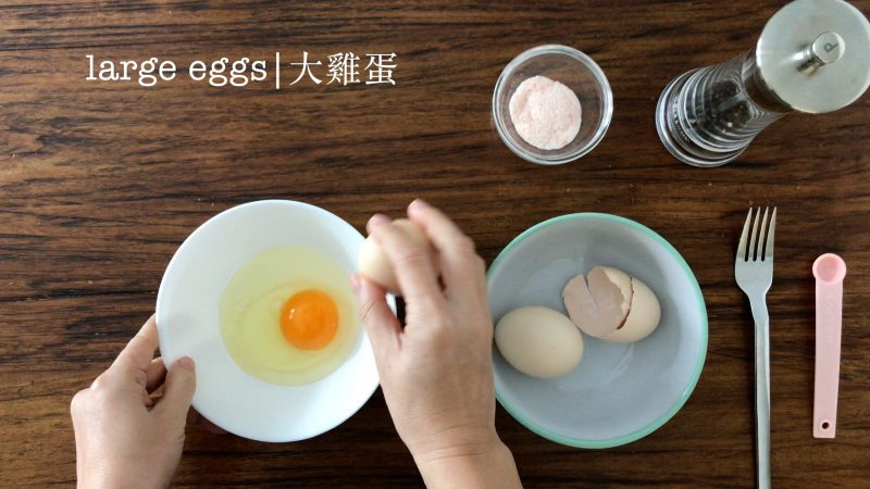 cracking an egg into a bowl