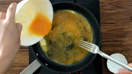 Pour whisked eggs into a pan with melted unsalted butter