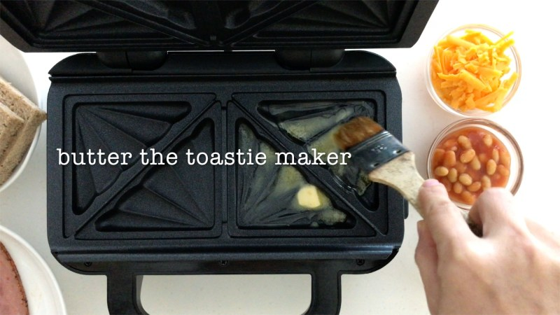 Brush melted unsalted butter all over a toasties maker