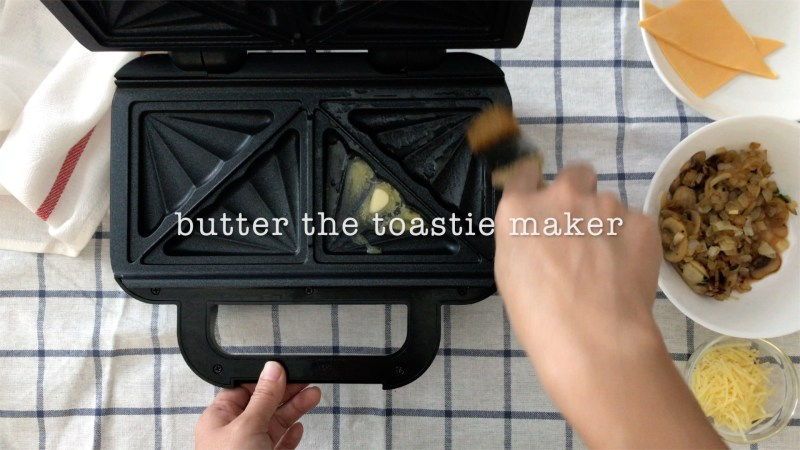brush melted butter all over the toasties maker