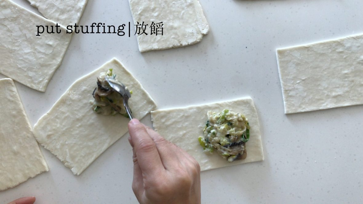 putting stuffing on all small rectangular puff pastry