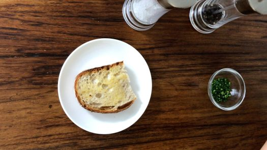 A slice of buttered toast in a white plate