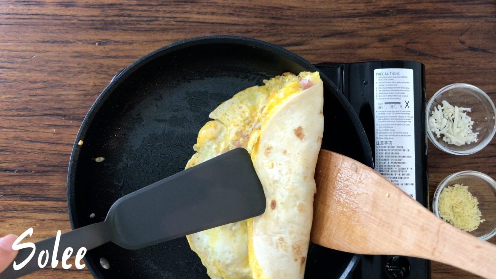 Fold the tortilla with two spatula