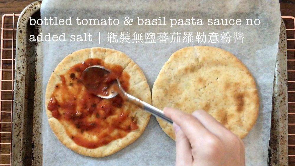 put pasta sauce on the browned pita bread with a table spoon