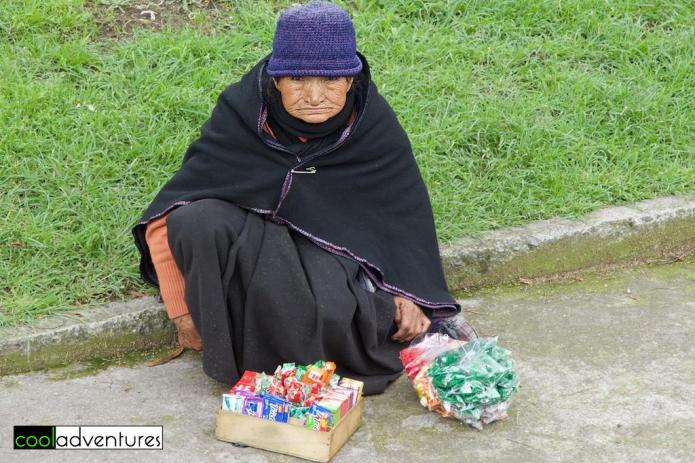 Andean woman selling candy, Quito, Ecuador