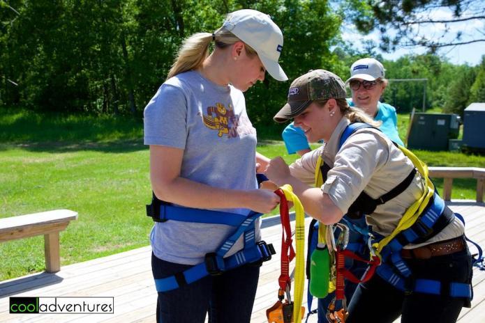 Caitlin Rick gearing up at Brainerd Zip Line Tour, Brainerd Lakes, Minnesota