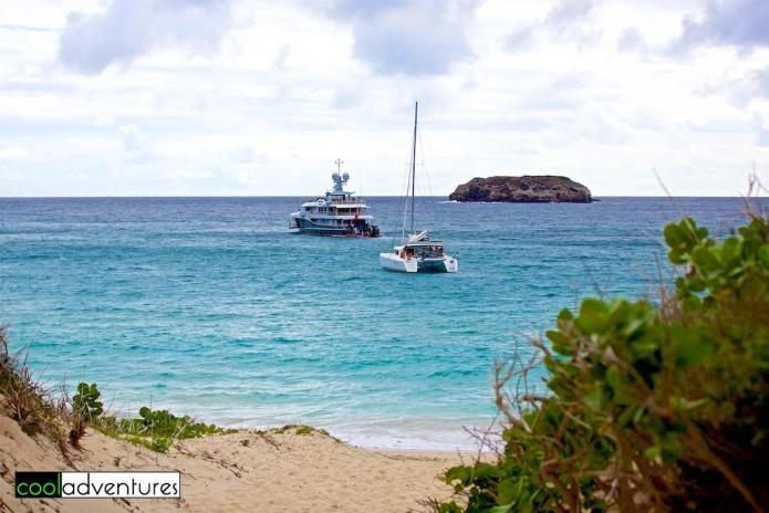 Climbing over the dunes at the entrance to Saline Beach in St. Barths