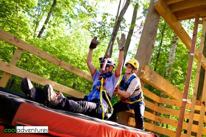 Kim Hull doing the free fall jump at Brainerd Zip Line Tour