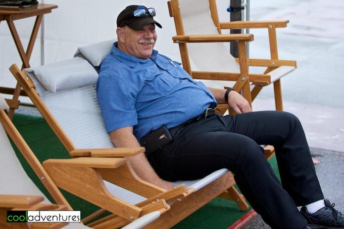Andy Rogers trying out the chairs at Street Faire at the Lakes
