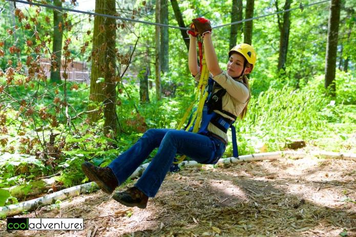 Amanda demonstrating on the training course at Brainerd Zip Line Tour