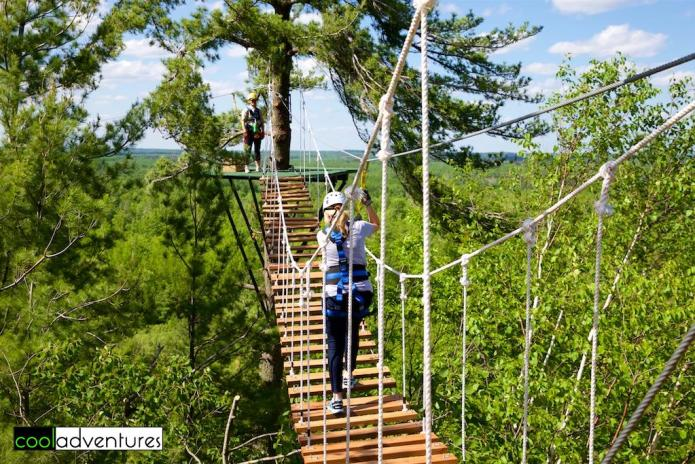 Caitlin Rick navigating the suspension bridge, Brainerd Zip Line Tour