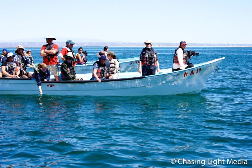 Kim Hull & other Searcher passengers in a panga, San Ignacio