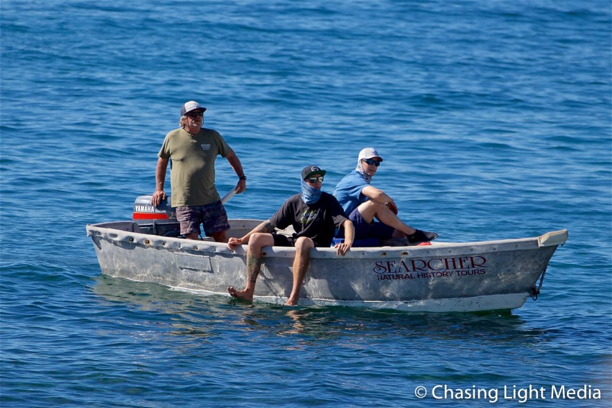 Kenny Merrell, Ryan Linden and Alec Robbie aboard a skiff