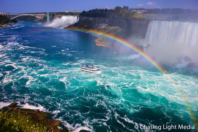 Rainbow stretching above the Maid of the Mist cruise boat, Niagara Falls, Ontario, Canada