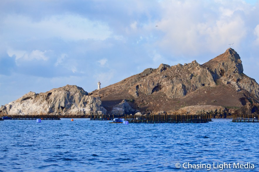 Lighthouse and offshore pens at fishing farm at Todos Santos