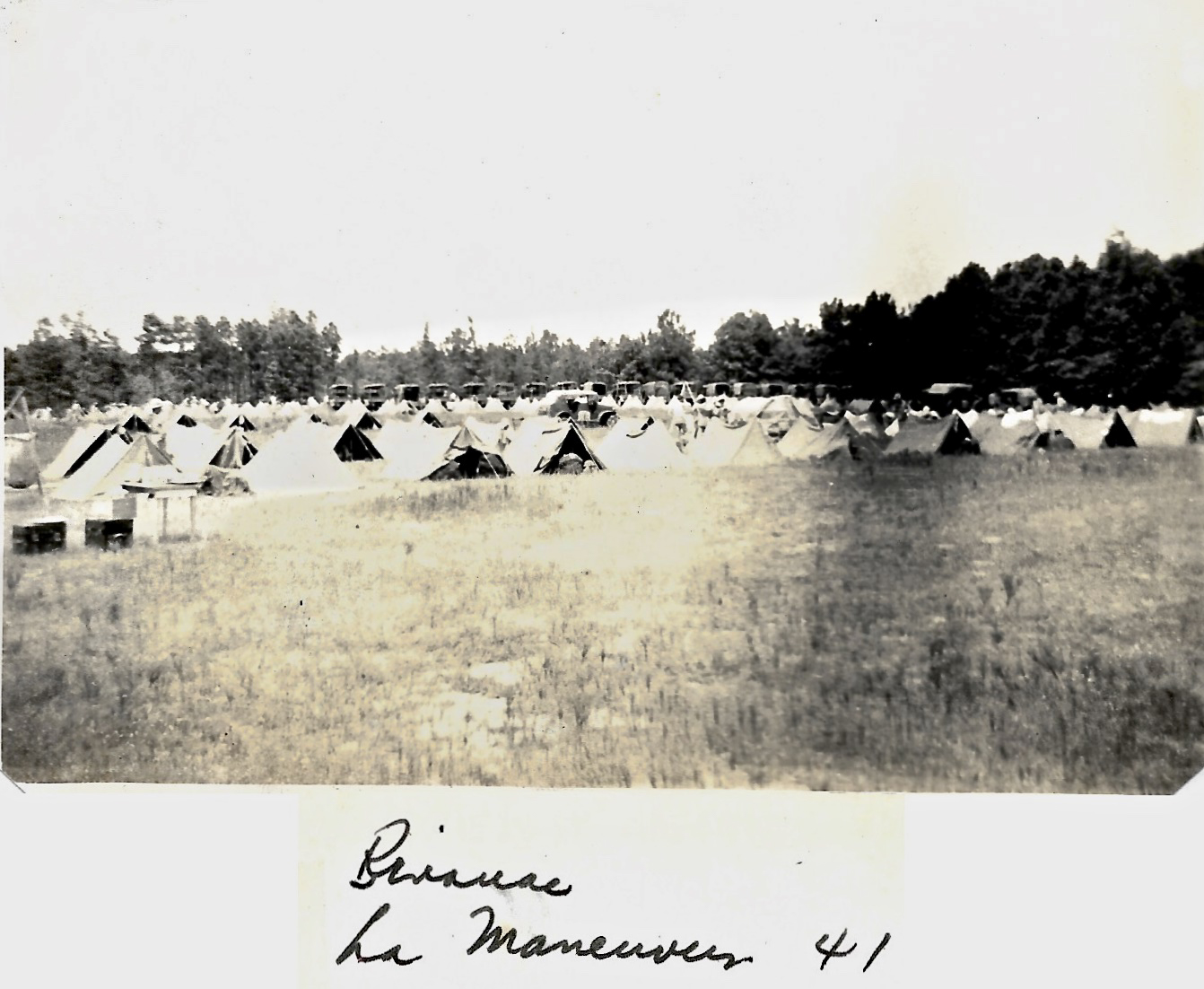 1941 Louisiana Maneuvers Tents and vehicles in field