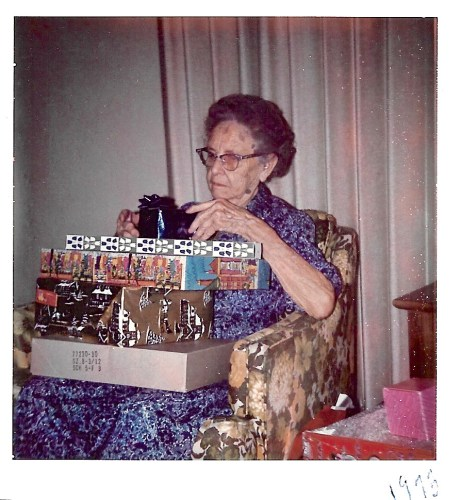 Myrtle Hooper Phillis opening gifts, Dec 1975, Independence, Kan