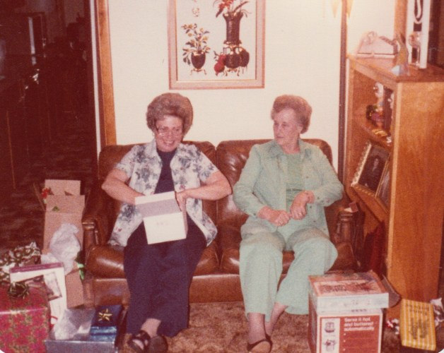 Evelyn Faulkner and Eleanor Baird opening presents, Christmas 1976