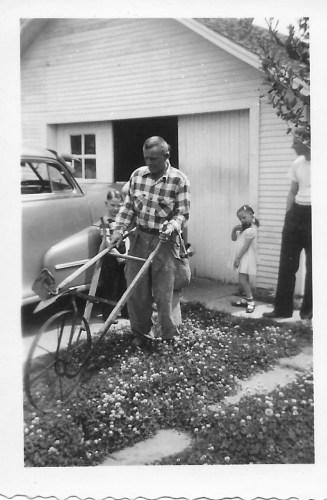 Hanley Baird with plow, Karen and Ernie Faulkner watching