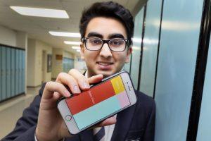 anmol-tukrel-holding-iphone