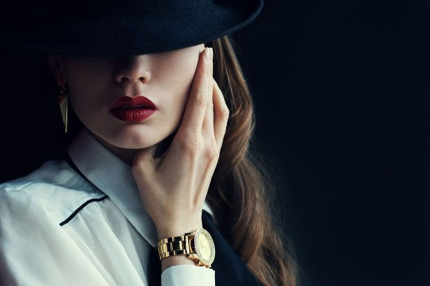Indoor portrait of a young beautiful fashionable woman wearing stylish accessories