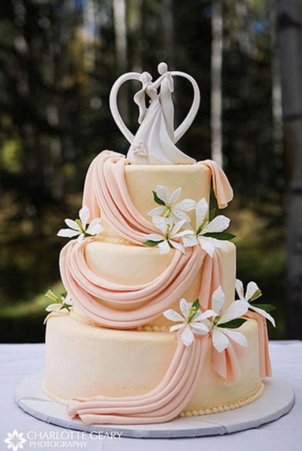 Orange wedding cake with cake topper