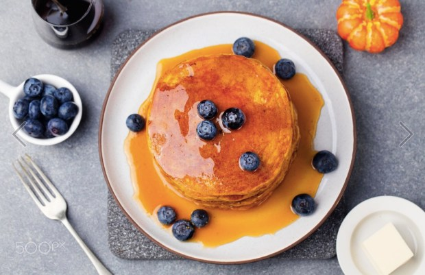 pumpkin-pancakes-with-maple-syrup-and-blueberries-on-a-plate