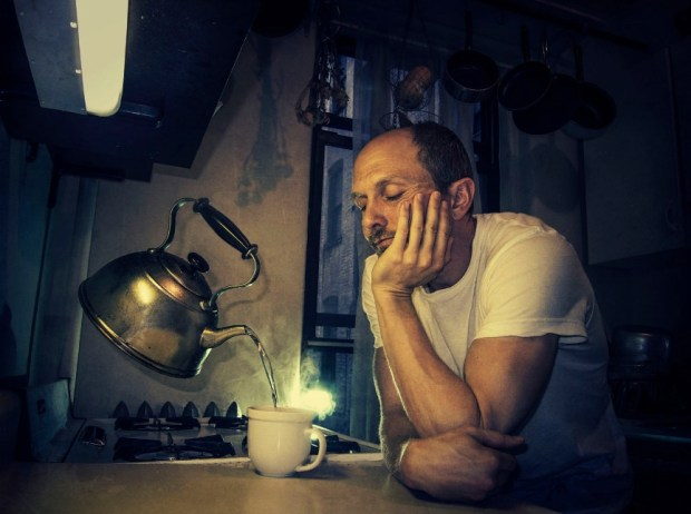 caucasian-man-pouring-cup-from-levitating-tea-kettle