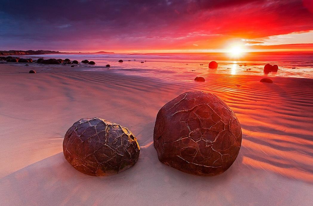 Moeraki Boulders during a stunning sunrise in New Zealand