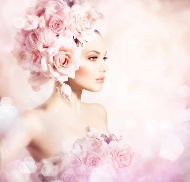 Fashion Beauty Model Girl with Flowers Hair