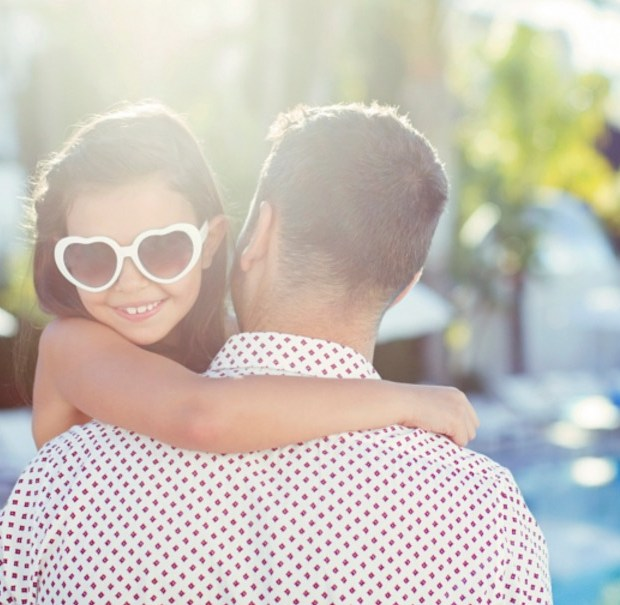 father-carrying-daughter-wearing-heart-shaped-sunglasses