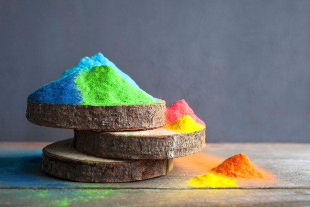 Bright colours on sawed wood for Indian holi festival