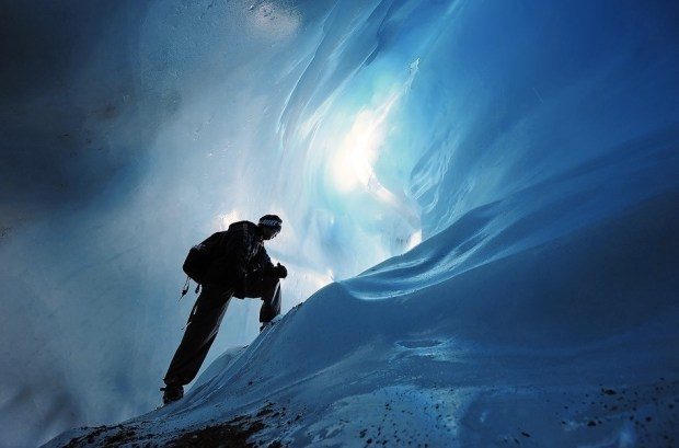 Man in an ice cave