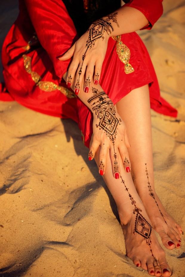 mehndi tattoo on beach sand background