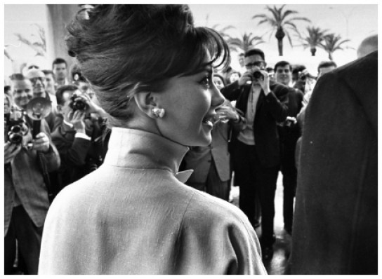 Actress Natalie Wood with actor Warren Beatty (only back of his shoulder showing) surrounded by photographers who are honing in on the famous pair on street during film festival.  (Photo by Paul Schutzer//Time Life Pictures/Getty Images)
