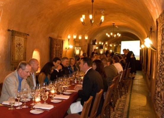 Interior low light photograph of a wine cave, table set and ready