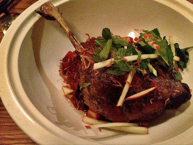Duck leg confit w/ red apple curry, crispy shallots and mint