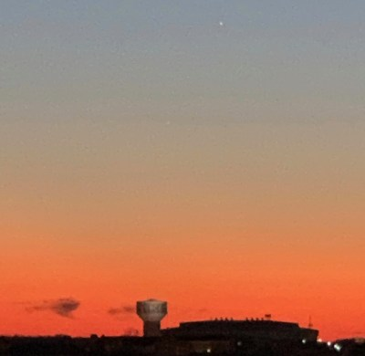 a sunset view of uncg water tower from a parking deck in downtown greensboro