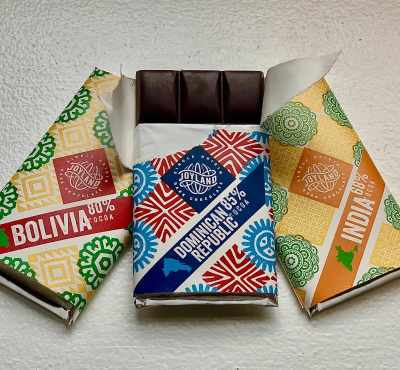 Joyland Provisions three chocolate bars with one opened at the top to show the bar under the wrapper chocolates greensboro nc
