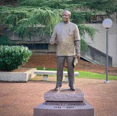 a photo of a statue of dr. george simpkins jr. of greensboro north carolina on the grounds of the old guilford county courthouse