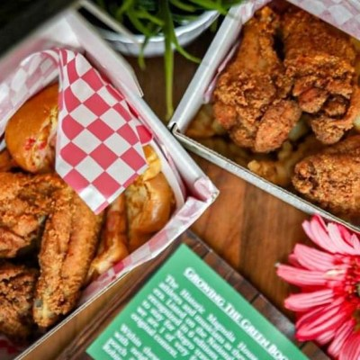 a photo of two shoebox lunches with fried chicken and boba toast from the historic magnolia house cafe and hotel