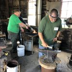 People working in the Bonanzaville smithy
