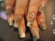 acrylic nail art with gold jewelry