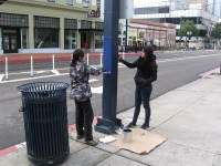 Volunteers paint lampposts in downtown San Diego!  Cool