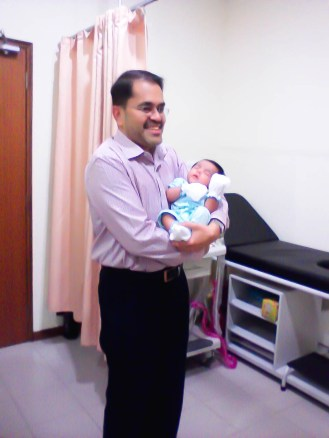 3 month old Jay in Dr. Fabian's arms